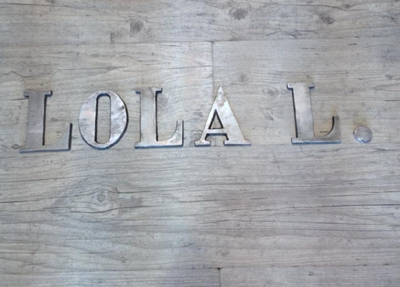 Lola L.